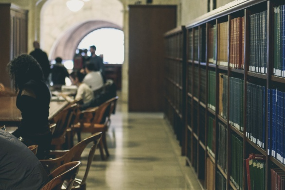 Photo of people studying in a library