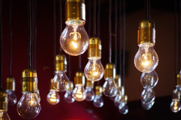 Photo of lightbulbs stringed down from the ceiling
