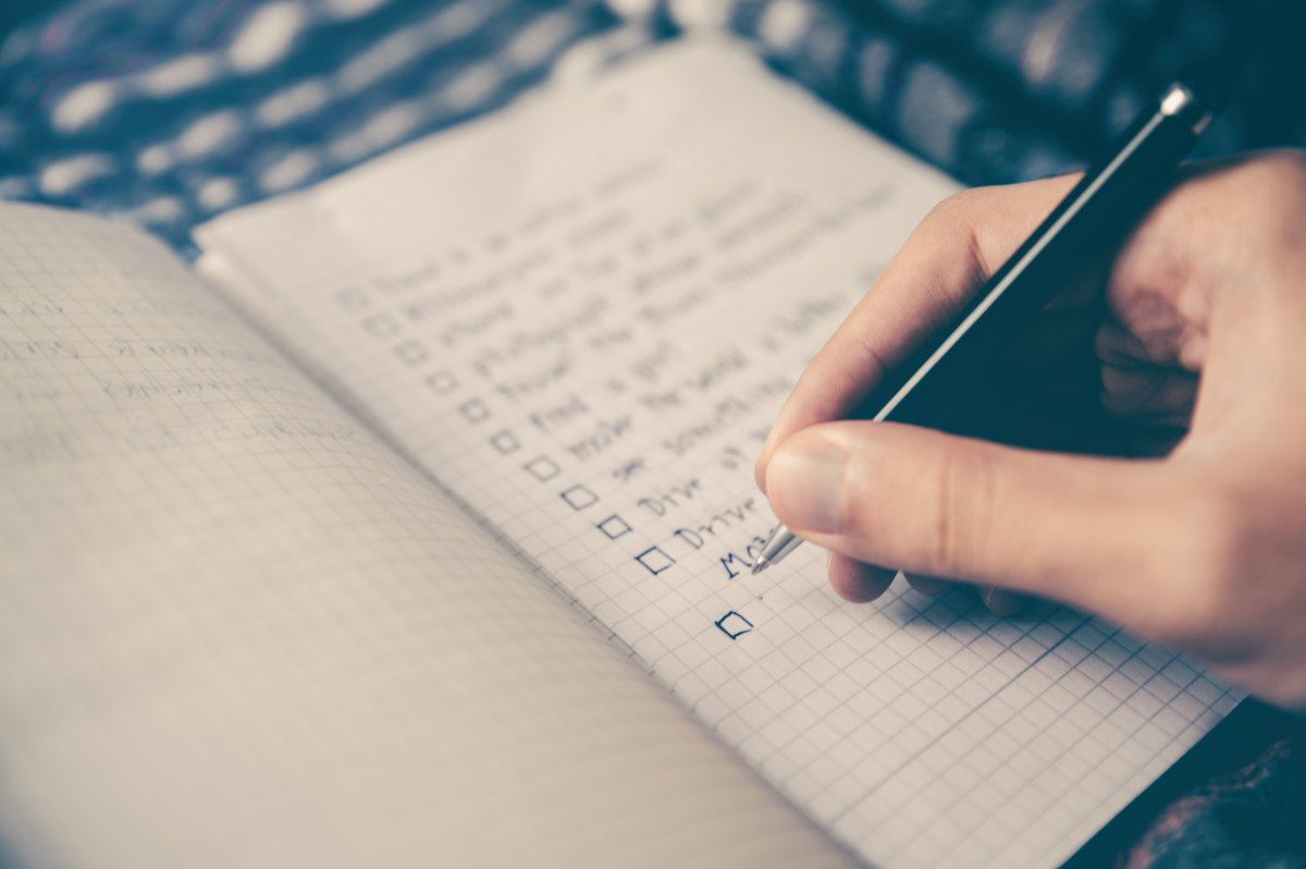 Photo of a written checklist in a notebook