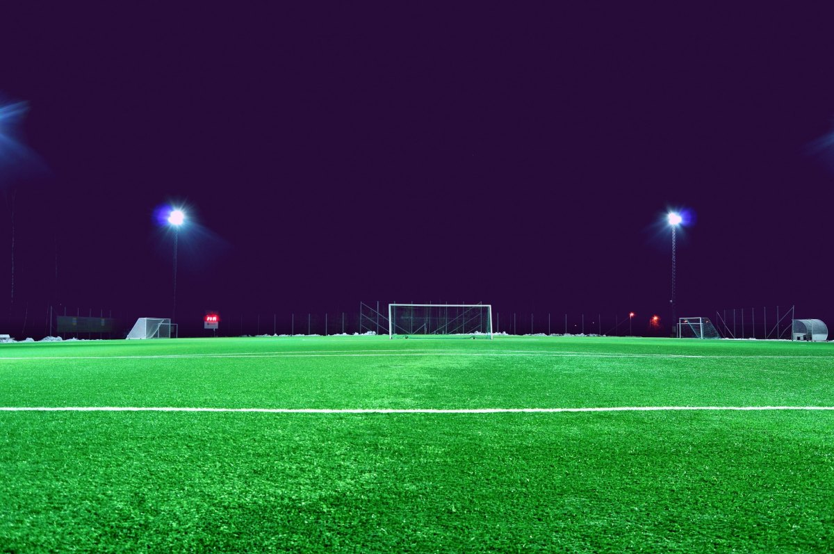 Photo of an empty soccer field at night