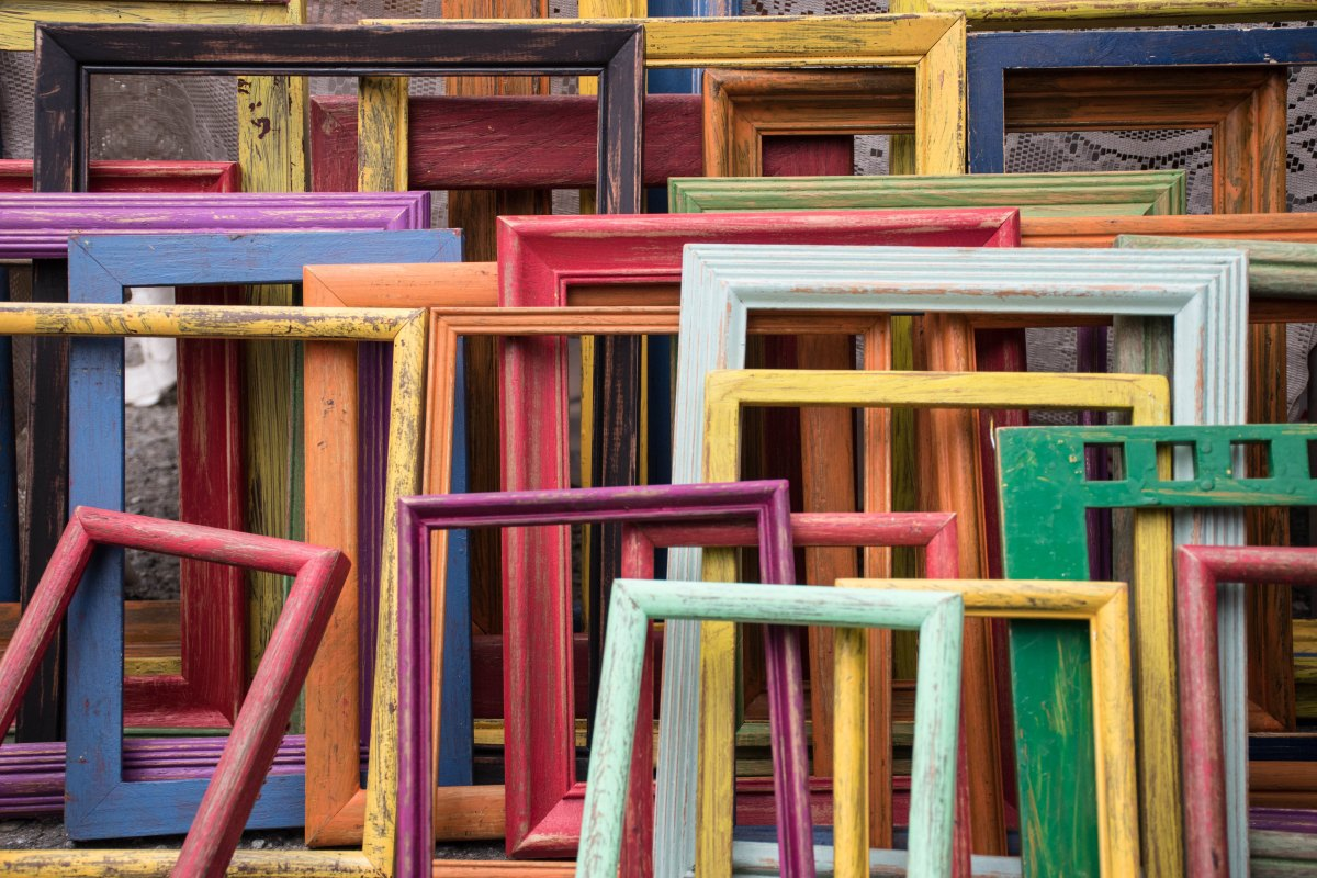 Photo of colorful, painted, empty picture frames